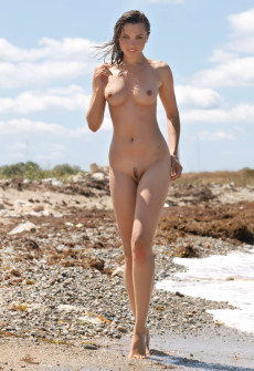 lady walking on beach naked