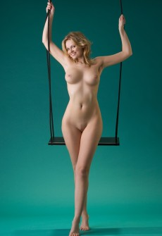 girl sitting on a swing nude