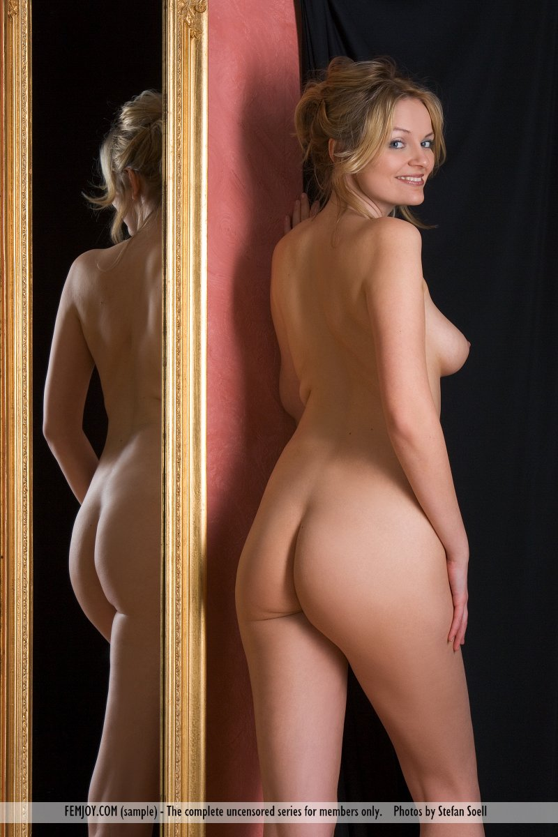 women posing naked on a mirror